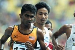 """""""Bại tướng"""" 5000m SEA Games của Nguyễn Văn Lai phá kỷ lục quốc gia bán marathon"""