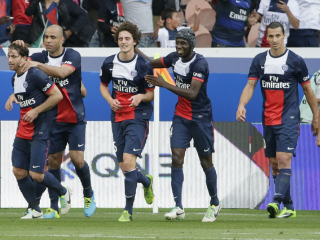 Paris Saint-Germain's French midfielder Adrien Rabiot (3rd L) celebrates with teammates during the French L1 football match between Paris Saint-Germain (PSG) and Guingamp at the Parc des Princes stadium in Paris, on August 31, 2013.  AFP PHOTO / KENZO TRIBOUILLARD        (Photo credit should read KENZO TRIBOUILLARD/AFP/Getty Images)